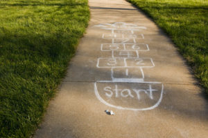Omaha, Nebraska, USA --- Hopscotch --- Image by © Philip Nealey/Somos Images/Corbis